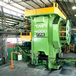 Presses for hot forging of steel and titanium
